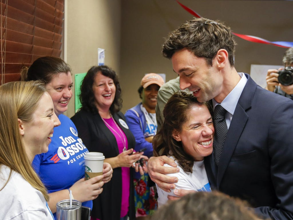 Democratic House of Representatives candidate Jon Ossoff greets volunteers on the morning of the special election at a campaign office in Atlanta on April 18, 2017. Ossoff is one of 18 candidates running in a non-partisan special election to fill Geo