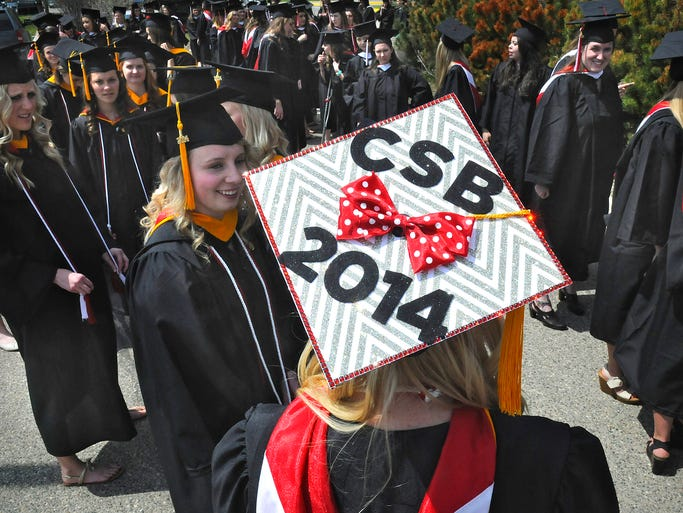 A brightly-decorated mortar board stands out in the crowd of 495 College of St. Benedict students during graduation Saturday in St. Joseph.
