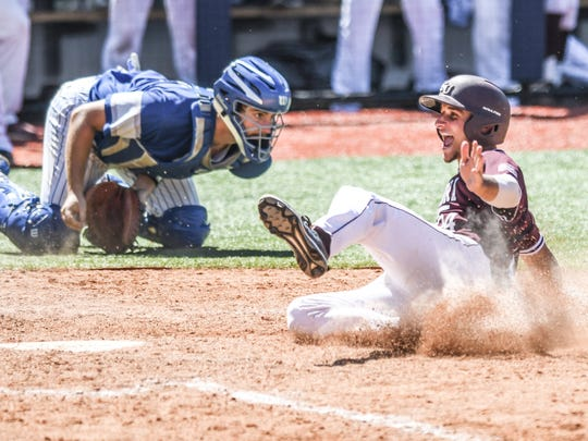 Missouri State catcher Drew Millas (24) scores the game winning run as St. Louis catcher James Morisano (18) takes the throw in the bottom of the 9th, in the NCAA Oxford Regional, at Oxford-University Stadium in Oxford, Miss. on Sunday, June 3, 2018. Missouri State won 9-8 on a walk off. (Bruce Newman, Oxford Eagle via AP)