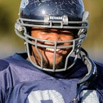 Nevada lineman Mundrae Clifton, shown laughing during a practice in 2008, died last week at age 28.
