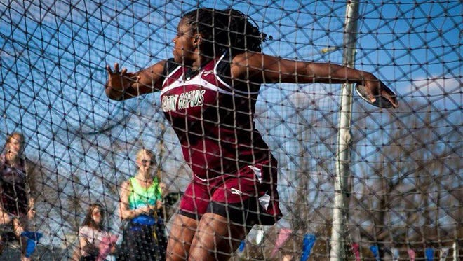 Eaton Rapids' Mary Hecksel, here throwing the discus at an earlier meet, capped her high school career with a Division 2 state championship on Saturday.