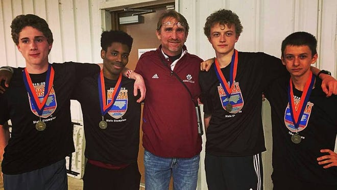Asheville High boys track coach Chris Stroup and his 3,200-meter relay team.