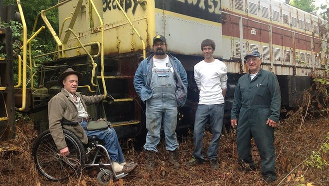 Sandy Duffy, left, T.J. Gaffney, Aaron Farmer and Bruce Sawdon of the Port Huron & Detroit Railroad Historical Society went to Knoxville to look at engine No. 52.