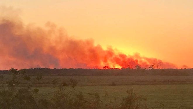 St. Lucie County firefighters battled a 120-acre fire in the 12000 block of Range Line Road on McCarty Ranch March 14, 2018.