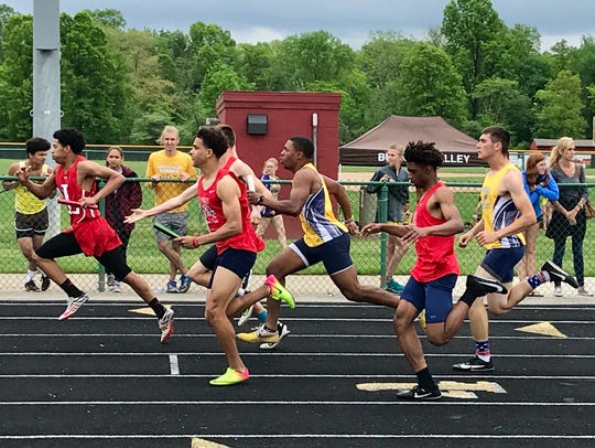 River Valley's Michael Glosser hands the baton to Michal