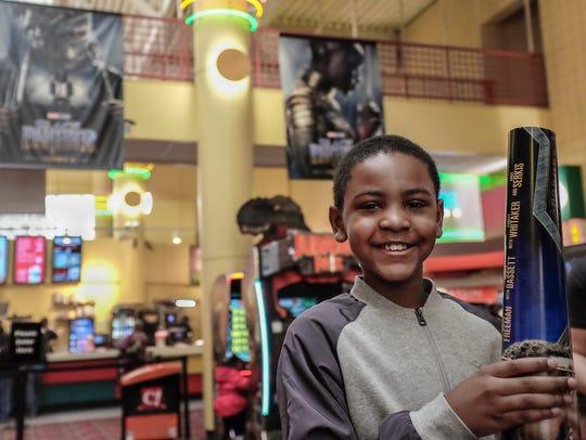 Daizuan Watkins, 9, from Lansing is all smiles as he