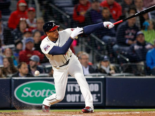 Atlanta Braves pinch hitter Hector Olivera (28) fouls a ball off in the fourth inning of a baseball game against the St. Louis Cardinals, Saturday, April 9, 2016, in Atlanta. The Cardinals won 12-2. (AP Photo/Brett Davis)
