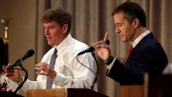 Democratic gubernatorial candidate Chris Koster, left, speaks along side Republican challenger Eric Greitens during the first general election debate in the race for Missouri governor at  the Missouri Press Association convention Friday, Sept. 30, 2016, in Branson, Mo. (AP Photo/Jeff Roberson)