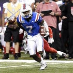 Louisiana Tech safety Xavier Woods (7) returns an interception against Arkansas State during last December's bowl win. Woods is one of the Bulldogs' top prospects for the 2017 NFL Draft class.