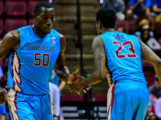 Michael Ojo (50) is substituted by Jarquez Smith (23) during the 75-67 Florida State University victory against Minnesota on Mon., Nov. 28, 2016 at the Donald L. Tucker Center in Tallahassee, FL.