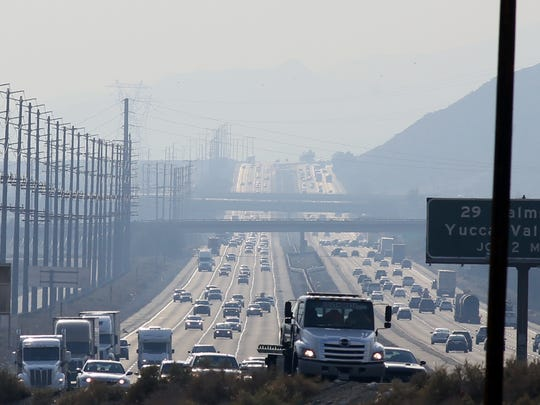 Traffic moves on Interstate 10 as haze blankets the Coachella Valley.
