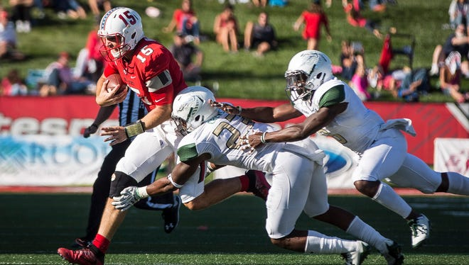 Ball State's Riley Neal runs against UAB in the home opener on Sept. 9 at Scheumann Stadium.