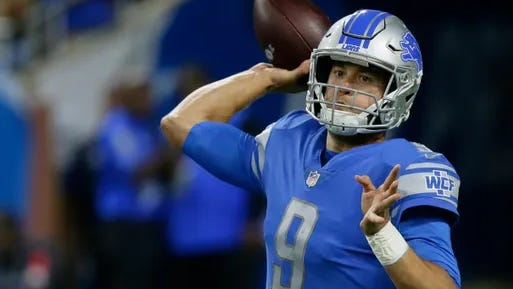 Detroit Lions quarterback Matthew Stafford throws during the first quarter against the New England Patriots, Sunday, Sept. 23, 2018, in Detroit.