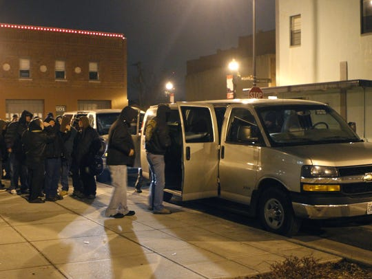 In this 2011 file photo, vans from East Sunshine Church