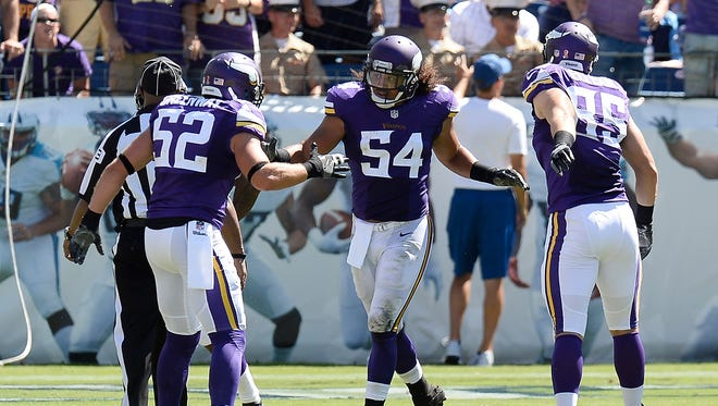 Minnesota Vikings linebacker Eric Kendricks (54) is congratulated by Chad Greenway (52) and Rhett Ellison (85) after Kendricks returned an intercepted pass 77 yards for a touchdown against the Tennessee Titans in the second half of an NFL football game Sunday, Sept. 11, 2016, in Nashville, Tenn.