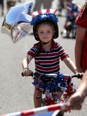 Jack Comer, 4, rides his bicycle during the Court-Chemeketa Fourth of July Kids Parade on Saturday, July 4, 2015.