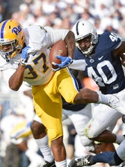 Pittsburgh's Qadree Ollison carries the ball before getting tackled by Penn State's Jason Cabinda (40) in the the second half of an NCAA Division I college football game Saturday, Sept. 9, 2017, at Beaver Stadium. Penn State defeated Pitt 33-14.