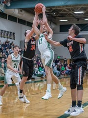 Pennfield's Ryan Vought (12) grabs the rebound against