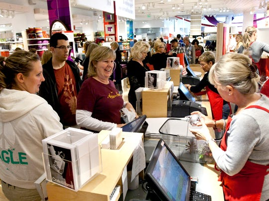 Shoppers  check out at the front registers during the after-Christmas sale at Crate & Barrel at Scottsdale Fashion Square in 2010.