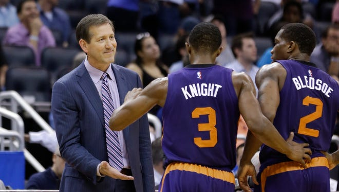 Phoenix Suns head coach Jeff Hornacek, left, congradultates Brandon Knight (3) as Eric Bledsoe (2) looks on after Knight picked off an inbound pass against the Orlando Magic in the closing seconds of an NBA basketball game, Wednesday, March 4, 2015, in Orlando, Fla. Phoenix won 105-100.