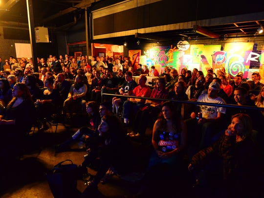 The room is packed for the first Democratic debate watch party at ArtsRiot in Burlington on Tuesday, Oct. 13, 2015.