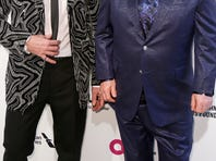 Elton John, right, and husband David Furnish, left, arrive at their AIDS Foundation Oscar Viewing Party.