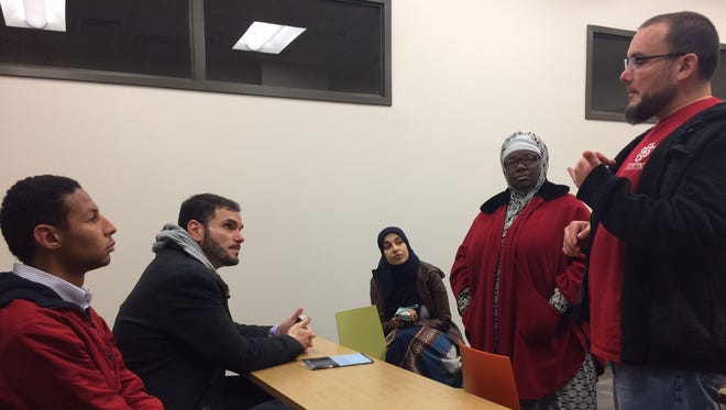 Paul Galloway, of the Nashville-based American Muslim Advocacy Center, talks to volunteers during an event preparation meeting at Casa Azafran. The American Muslim Advisory Council is hosting a Muslim community day at the Tennessee State Capitol.