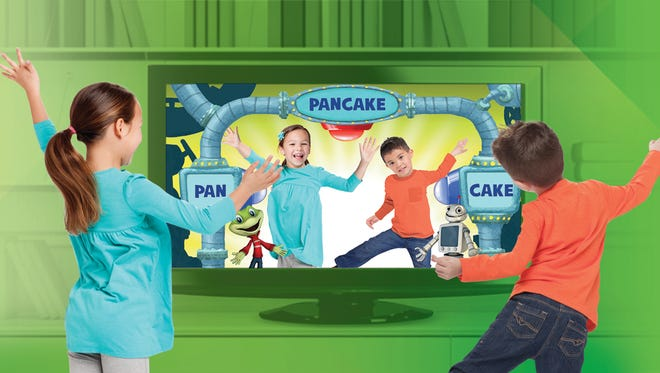 Kids dance while also creating compound words in Dance & Learn, a separate game for the LeapTV gaming system that encourages players to be active while they learn.