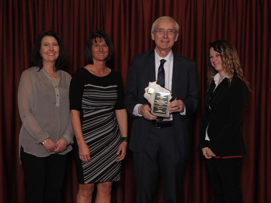 G.D. Jones teacher Julie Fernstaedt stands with Principal Robin Kordus, State Superintendent Tony Evers and parent Kristin Ruleau to accept the award.