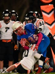 St. Cloud Apollo wide receiver John Sithamat is stopped