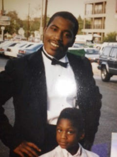 Marshawn Lynch, bottom, with his father, Maurice Sapp, in an undated photo.