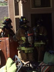 Firefighters are at the scene of a house fire Monday,