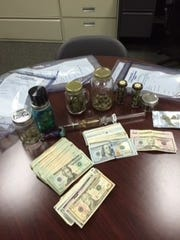 Drugs and cash found after warrant served in Bonita
