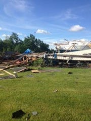 A polebarn collapsed off Braidwood Road near Memphis and Emmett Monday, June 22, 2015 after a small tornado swept through the area.
