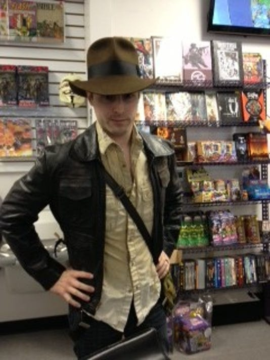 "Alex Levitsky, manager at Planet X Comics and Collectibles, dressed as Indiana Jones as preparation for Hurricane Sandy. ""If you're dressed as Indiana Jones, there's nothing you can't survive,"" Levitsky said."