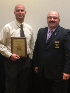 Carroll County sheriff's Deputy Darron Giancola and Carroll County Sheriff Tobe Leazenby. Giancola is holding the Indiana Sheriff's Association Life Saving Award he received earlier this summer.