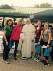 Marybeth Dillon Butler, Cathy Dillon, cardboard cut-out of Pope Francis, Coleen Egan and C.J. Dillon as they were about to board a train into Philadelphia. Coleen is from Troy, and C.J., Cathy's daughter, is from Farmington Hills.