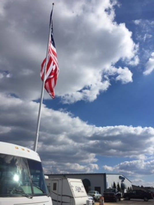 A 40-by-80 foot flag waves in the air at Camping World along Baltimore Pike in Hanover. The RV and outdoor retailer and Good Sam, an RV owners association, have raised massive flags at several store locations throughout the country since 2014 as a way to show appreciation for veterans and active members of the military. A dedication ceremony was held Monday.