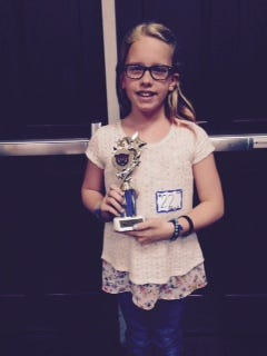 Alexa Travis of Baton Rouge won the upper elementary division of Louisiana College's first home school spelling bee Jan. 21.