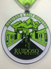 marathon and half marathon runners that registered early will receive a medal for their efforts.