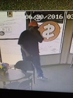 The Greenville Police Department released this image of a suspect after a payday loan business was robbed at gunpoint.
