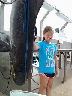 Emma Zajdel, 9, of Ocean City, has set a new state fishing record with a 94.6-pound cobia.