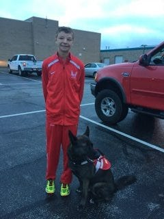 Davenport West's Tyler Gerdts and his service dog, Hugo, pose for a photo before their meet at Cedar Rapids Prairie on Saturday, Aug. 27, 2016.