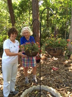 Garden Club of Stuart members Ruth Anne Decker and Joanne Gamba planted portulaca moss roses on a shepherd's hook at Possum Long Nature Center in Stuart.