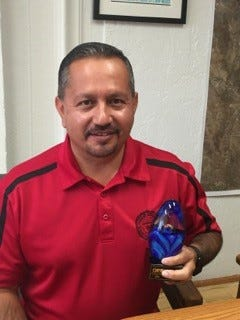 Silver City Town Manager Alex Brown holds the 2016 New Mexico Energy Manager of the Year Award, presented by the New Mexico Association of Energy Engineers.