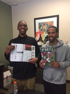 Hughes senior Corry Long with Big Red head coach Bryan Wyant and the issue of Sports Illustrated in which Long is featured.