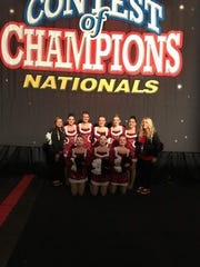 Pacelli Dance Team coach Tricia Cashin (standing far left) helped lead the Cardinals to a first-place finish at the Contest of Champions national competition in 2014.
