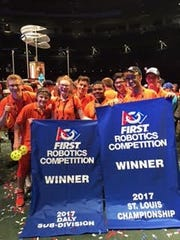 Members of Team 862 from Plymouth-Canton celebrated their subdivision win and a national title.