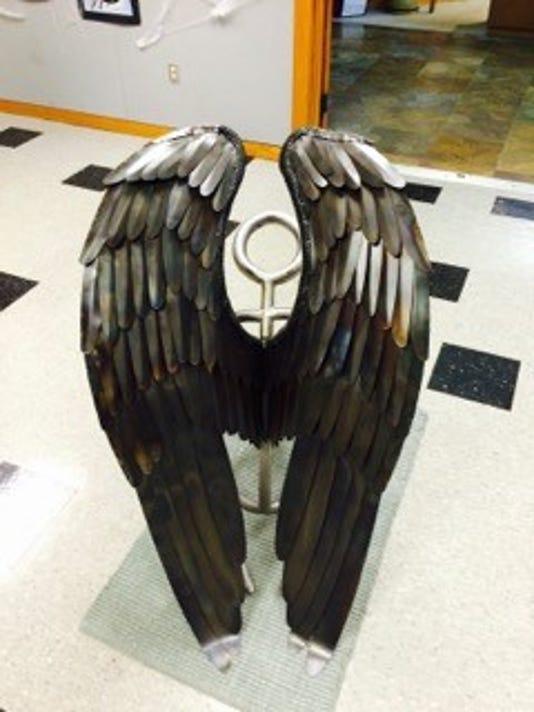 636362302765979860-slh.art-work-wings.jpg