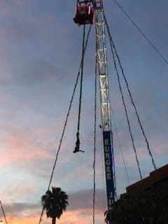 A person hangs from the bungee ride waiting to be rescued on Wednesday night at the Ventura County Fair.